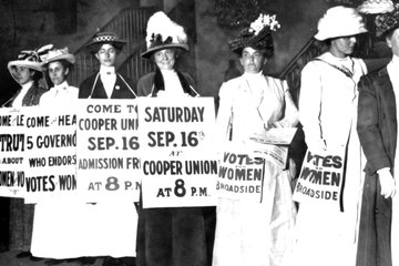 women's suffrage activists with signs, circa turn of the 20th century