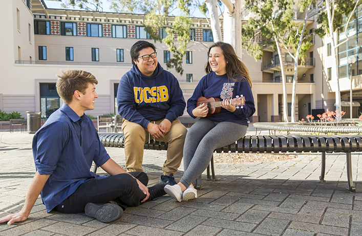 Students sitting together on a college campus.