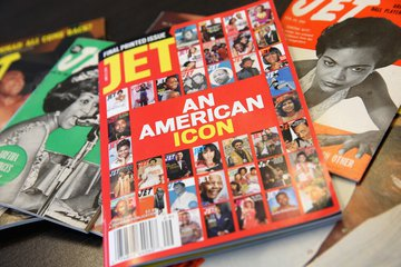 "stack of archival magazines, headline on top issue reads ""JET An American Icon."""